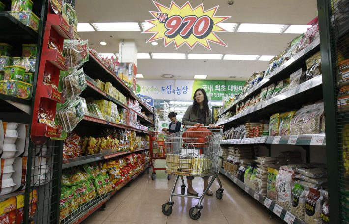 People shop at a supermarket in Seoul