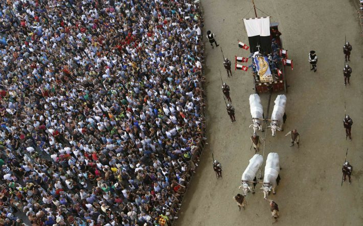 "The ""Cencio"" is carried during a historical parade before the Palio of Siena horse race"